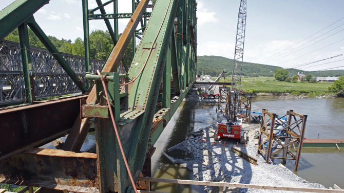 In this May 30, 2012 photo, the Checkered House Bridge is under construction in Richmond, Vt. Vermont highway engineers have been trying to decide what to do about the U.S. Route 2 bridge over the Winooski River for almost a quarter century. AP Photo/Toby Talbot)