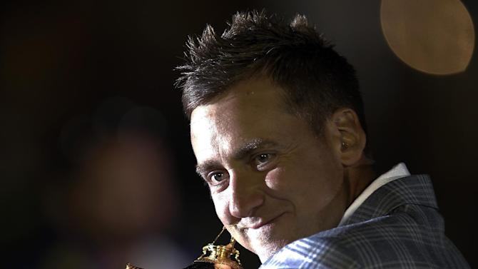 Europe's Ian Poulter hugs the trophy after winning the Ryder Cup PGA golf tournament Sunday, Sept. 30, 2012, at the Medinah Country Club in Medinah, Ill. (AP Photo/David J. Phillip)