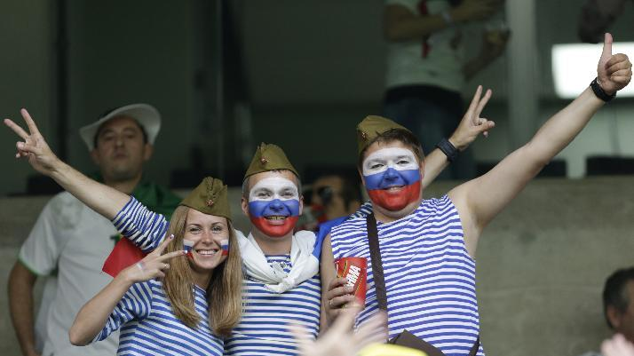 Russia fans cheer before the group H World Cup soccer match between Algeria and Russia at the Arena da Baixada in Curitiba, Brazil, Thursday, June 26, 2014