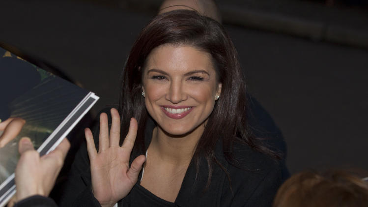 Actress Gina Carano arrives for the photo call of the film Haywire at the 62 edition of the Berlinale, International Film Festival in Berlin, Wednesday, Feb. 15, 2012. (AP Photo/Gero Breloer)