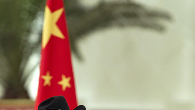 South Sudan's President Salva Kiir, left, stands with Chinese President Hu Jintao, while national anthems are played during a welcoming ceremony at the Great Hall of the People in Beijing, China, Tuesday, April 24, 2012. (AP Photo/Alexander F. Yuan)