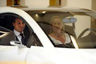 Actress Sharon Stone and Lotus CEO Dany Bahar unveil the new Lotus Esprit at the 2010 Los Angeles Auto Show. Bahar has filed a wrongful dismissal suit, the British sports car maker&#39;s Malaysian parent says