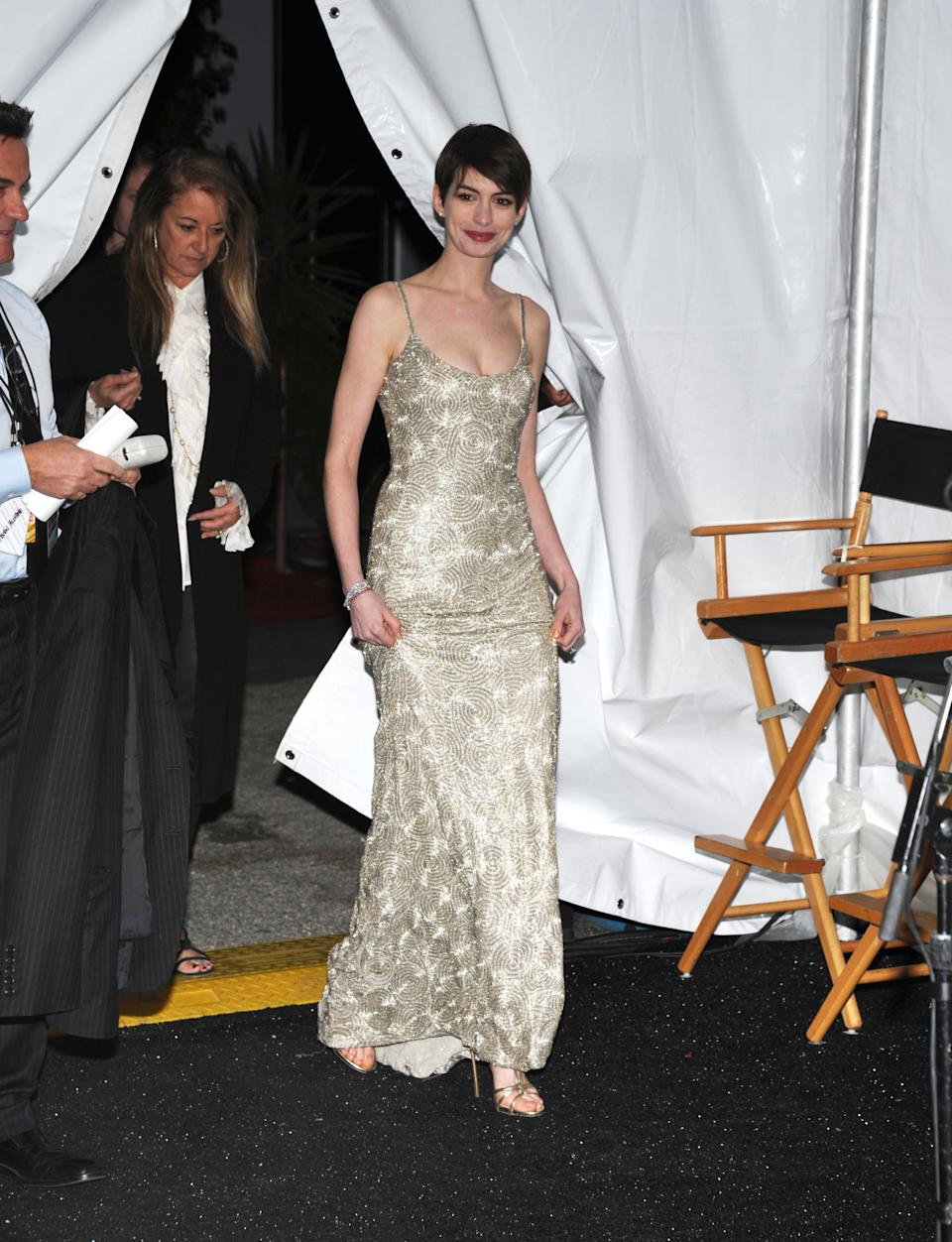 "Anne Hathaway is seen backstage after accepting the award for best supporting actress for ""Les Miserables"" at the 18th Annual Critics' Choice Movie Awards at the Barker Hangar on Thursday, Jan. 10, 2013, in Santa Monica, Calif. (Photo by John Shearer/Invision/AP)"