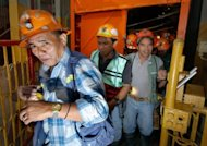 Filipino miners step out of the elevator after their shift in Padcal. hief regulator Leo Jasareno, head of the environment department's Mines and Geosciences Bureau, told AFP that Philex Mining is under state orders to plug the Padcal leak immediately, but added neither side could give a timetable