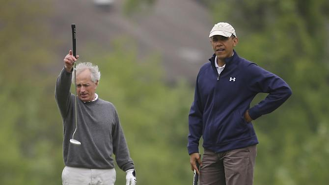 President Barack Obama, right, with Sen. Bob Corker, R-Tenn., left, on the first hole of the golf course at Andrews Air Force Base, Monday, May 6, 2013. (AP Photo/Pablo Martinez Monsivais)