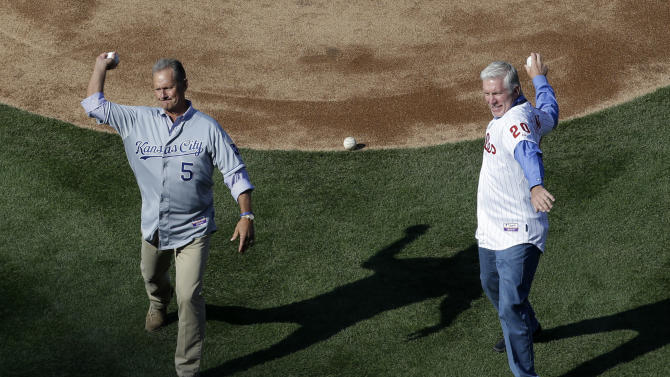 Former Kansas City Royals' George Brett, left, and former Philadelphia Phillies' Mike Schmidt throw out ceremonial first pitches before an opening-day baseball game between the Philadelphia Phillies and the Kansas City Royals, Friday, April 5, 2013, in Philadelphia. (AP Photo/Matt Rourke)