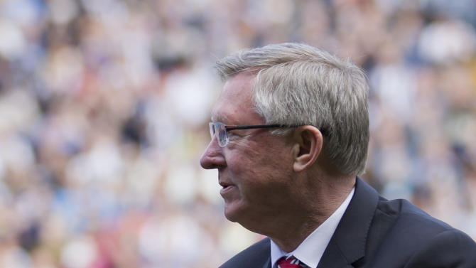 Manchester United manager Sir Alex Ferguson applauds supporters before his last game in charge of his team, their English Premier League soccer match against West Bromwich Albion at The Hawthorns Stadium, West Bromwich, England, Sunday May 19, 2013. (AP Photo/Jon Super)