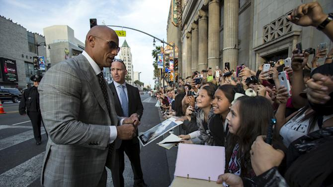 "Cast member Johnson talks to fans at the premiere of ""San Andreas"" in Hollywood"