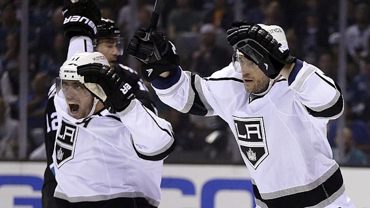 Los Angeles Kings' Anze Kopitar, left and Marian Gaborik celebrate a goal by Jake Muzzin during the first period of Game 2 of an NHL hockey first-round playoff series against the San Jose Sharks Sunday, April 20, 2014, in San Jose, Calif. (AP Photo/Ben Margot)