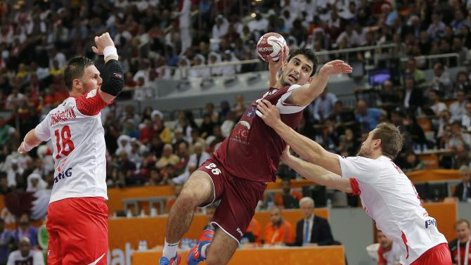 Mallash of Qatar attempts to score between Grabarczyk and Rojewski of Poland during their semi-final match of the 24th Men's Handball World Championship in Doha