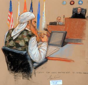 In this photo of a sketch by courtroom artist Janet Hamlin and reviewed by the U.S. Department of Defense, Khalid Sheikh Mohammed sits at a defense table wearing a camouflage vest in front of military judge U.S. Army Col. James Pohl, right, during the third day of the Military Commissions pretrial hearing against the five Guantanamo prisoners accused of the Sept. 11 terrorist attacks at the Guantanamo Bay U.S. Naval Base in Cuba, Wednesday, Oct. 17, 2012. Khalid Sheikh Mohammed, who has told authorities he was the mastermind of the Sept. 11 hijacking plot, wore the woodland-style camouflage vest for the first time Wednesday, a clothing choice previously denied because of fears it might disrupt the court. (AP Photo/Janet Hamlin, Pool)