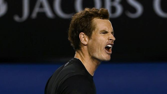 Andy Murray of Britain reacts after winning a point against Grigor Dimitrov of Bulgaria in their men's singles fourth round match at the Australian Open 2015 tennis tournament in Melbourne