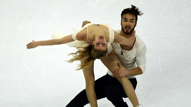 Gabriella Papadakis (L) and Guillaume Cizeron of France compete in the ice dance free dance program during the 2015 ISU World Figure Skating Championships in Shanghai, on March 27, 2015