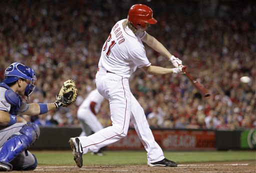 Kemp leads Dodgers over Reds 3-1 in 10 innings