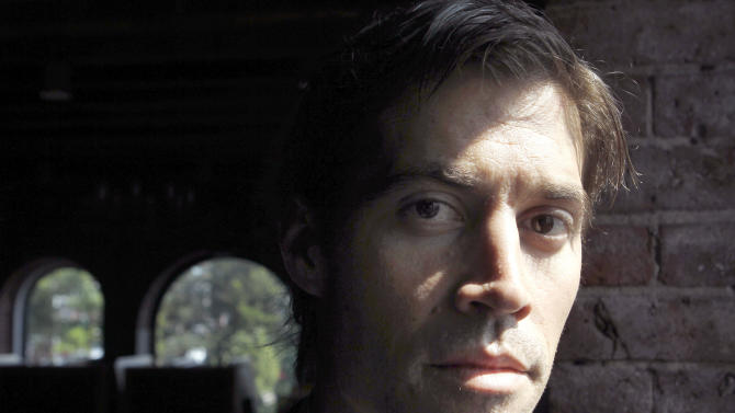FILE - In this May 27, 2011 file photo, American journalist James Foley, of Rochester, N.H., poses for a photo in Boston. The parents of Foley, last seen on Nov. 22, 2012, in northwest Syria, were to speak about him at a World Press Freedom Day event in Boston, Friday, May 3, 2013. World Press Freedom Day is held each year to raise awareness about journalists around the world, who are censored, arrested, attacked or murdered because of their work. (AP Photo/Steven Senne, File)