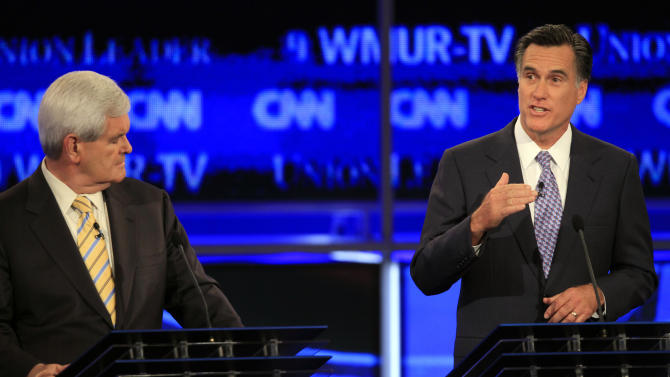 Former Massachusetts Gov. Mitt Romney answers a question during the first New Hampshire Republican presidential debate at St. Anselm College in Manchester, N.H., Monday, June 13, 2011, as former House speaker Newt Gingrich listens. (AP Photo/Jim Cole)