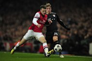 Arsenal midfielder Aaron Ramsey (left) challenges Bayern Munich's German midfielder Toni Kroos during their UEFA Champions League match at the Emirates stadium in north London on February 19, 2013. Having impressed in Tuesday's Champions League victory at Arsenal, Bayern Munich, who enjoy a record 15-point lead in the Bundesliga, are also proving to be Germany's football champions of social media