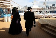 Passengers wear period clothing as they stand on the deck of the Azamara Journey on April 10 in New York City. Titanic fans aboard cruise ships are journeying to the spot where the great liner hit an iceberg exactly 100 years ago on Sunday, as somber ceremonies were held on land to mark the disaster