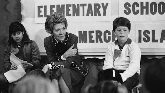 "FILE - In this Feb. 14, 1984 file photo, first lady Nancy Reagan sits with a fourth and fifth grade class at Island Park Elementary School on Mercer Island, Wash. where she participated in a drug education class. At left is Amy Clarfeld, 10, and Andrew Cary, 10, is at right. During a visit with schoolchildren in Oakland, Calif., Reagan later recalled, ""A little girl raised her hand and said, 'Mrs. Reagan, what do you do if somebody offers you drugs?' And I said, 'Well, you just say no.' And there it was born."" On the occasion of  ""Legalization Day,"" Thursday, Dec. 6, 2012, when Washington's new law takes effect, AP takes a look back at the cultural and legal status of the ""evil weed"" in American history. (AP Photo/Barry Sweet, File)"