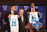 New Orleans Hornets NBA basketball team owner Tom Benson is flanked by 2012 Draft picks Austin Rivers, left, and Anthony Davis in New Orleans, Friday, June 29, 2012. Davis was the first pick in the 2012 NBA Draft Thursday night. Rivers was picked 10th.  (AP Photo/Kerry Maloney)
