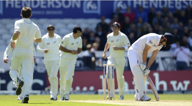 England's Cook looks down after being dismissed during the second test cricket match against New Zealand at Headingley cricket ground in Leeds