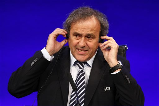 UEFA President Michel Platini speaks to members of the media at the end of the 37th Ordinary UEFA Congress in London, Friday, May 24, 2013