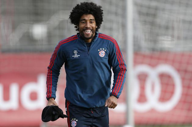 Bayern's Dante of Brazil laughs during a last training session prior the Champions League group D soccer match between FC Bayern Munich and Manchester City, in Munich, southern Germany, Monday, De