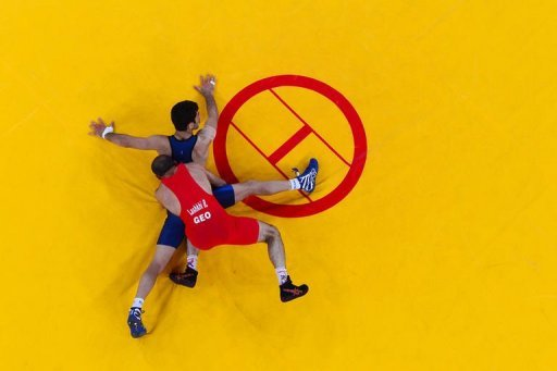 Georgia's Revaz Lashkhi (red) competes with Iran's Omid Haji Noroozi during their Men's 60kg Greco-Roman Gold Medal fight on Day 10 of the London 2012 Olympic Games at ExCeL in London. Noroozi won the greco-roman wrestling 60kg Olympic gold medal
