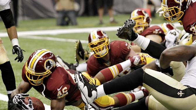 Washington Redskins running back Alfred Morris (46) scores a touchdown in the second half of an NFL football game against the New Orleans Saints at the Mercedes-Benz Superdome in New Orleans, Sunday, Sept. 9, 2012. (AP Photo/Matthew Hinton)