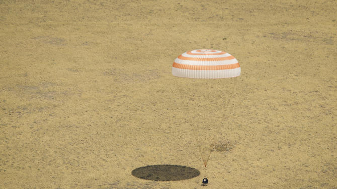 The Soyuz TMA-03M spacecraft is seen as it lands with Expedition 31 Commander Oleg Kononenko of Russia and Flight Engineers Don Pettit of NASA and Andre Kuipers of the European Space Agency in a remote area near the town of Zhezkazgan, Kazakhstan, on Sunday, July 1, 2012.  Pettit, Kononenko and Kuipers returned from more than six months onboard the International Space Station where they served as members of the Expedition 30 and 31 crews. (AP Photo/NASA, Bill Ingalls)