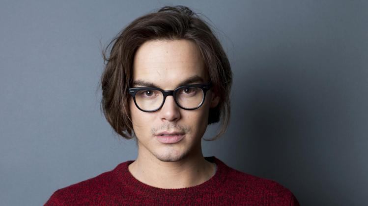 "FILE - This Jan. 2, 2013 file photo shows actor Tyler Blackburn, from ABC's ""Pretty Little Liars"" series, in New York. ABC Family announced Tuesday, April 30, that Blackburn will star in the spin-off series ""Ravenwood."" (Photo by Amy Sussman/Invision/AP, file)"