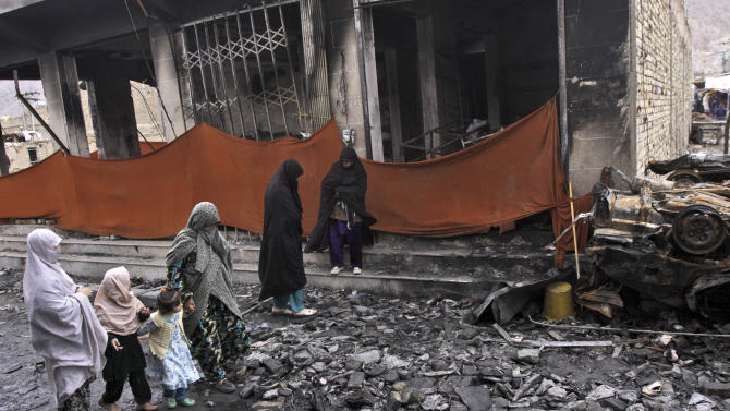 In this Friday, Feb. 22, 2013 photo, Pakistani women walk in a market which was hit by a bomb blast on Saturday, February 16, 2013, in Quetta, Pakistan. Terrorized by ferocious attacks that have killed nearly 400 ethnic Hazaras in the past 18 months, with almost half of those deaths occurring in the first two months of this year, Shiite leaders blamed the inaction of Pakistan's security service for the rising violence against them in Quetta, the capital of southwestern Baluchistan province.(AP Photo/Arshad Butt)