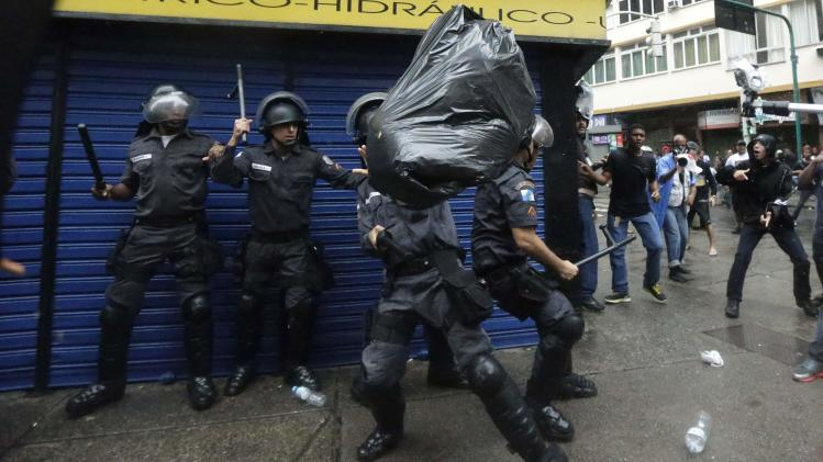 Residents of Pavao-Pavaozinho slum clash with riot policemen during a protest against the death of Douglas Rafael da Silva Pereira in Rio de Janeiro