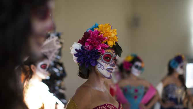 Models are pictured at a press reception ahead of the 15th annual Dia de los Muertos, or Day of the Dead, festival at Hollywood Forever Cemetery in Los Angeles