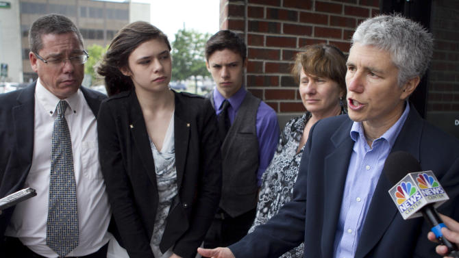 Jennifer Levi, attorney for transgender student Nicole Maines, second from left, speaks to reporters outside the Penobscot Judicial Center, Wednesday, June 12, 2013, in Bangor, Maine. The state supreme court heard arguments on Wednesday over a school district's handling of Nicole Maine's restroom needs. Also pictures are Nicole's father Wayne Maine, left, twin brother Jonas Maines, center, and mother Kelly Maines.(AP Photo/Robert F. Bukaty)