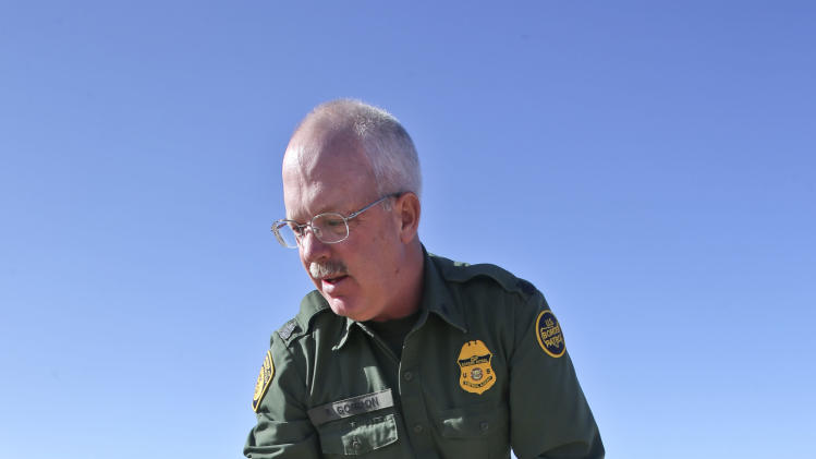 "In this Monday, March 25, 2013 photo, Border Patrol agent Richard Gordon, a 23-year veteran of the agency, holds a small bunch of leaves as he demonstrates how illegal immigrant brush their foot prints while trying to avoid being tracked by Border Patrol agents after entering the United States in the Boulevard area east of San Diego in Boulevard, Calif. For the past 16 years, Gordon has been one of the top ""sign-cutters"" or trackers in the Border Patrol. (AP Photo/Lenny Ignelzi)"