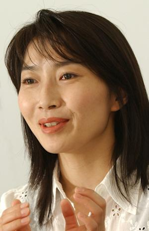 In this May 7, 2004 photo, Mika Yamamoto speaks in Tokyo. The Japanese journalist was killed in Syria while covering the civil war there, the Japanese government said Tuesday, Aug. 21, 2012. (AP Photo/Kyodo News) JAPAN OUT, MANDATORY CREDIT, NO LICENSING IN CHINA, HONG KONG, JAPAN, SOUTH KOREA AND FRANCE