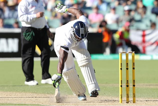 England's Michael Carberry slides his bat to avoid a run out during the second Ashes cricket test match between England and Australia, Adelaide, Australia, Friday, Dec. 6, 2013