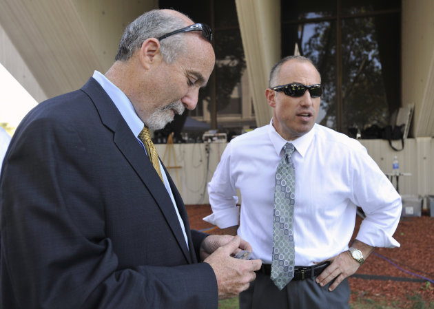 In this Sept. 6, 2012 file photo, Joel Brodsky, left, and Steven Greenberg, attorneys for former Bolingbrook police officer Drew Peterson, confer outside the Will County Courthouse in Joliet, Ill., du