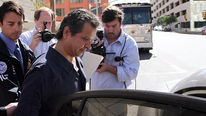 Marco Antonio Delgado is placed into a car outside of the El Paso County Jail, Monday, Nov. 5, 2012 in El Paso, Texas. Delgado was arrested by Immigration and Customs Enforcement on charges of conspiracy to commit money laundering according to jail records. (AP Photo/Juan Carlos Llorca)