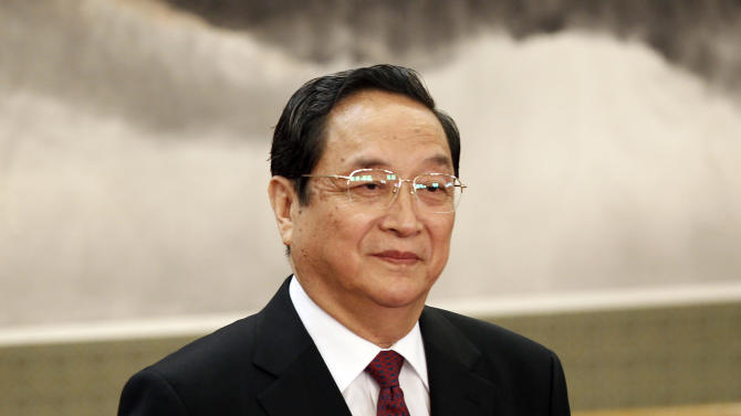 Yu Zhengsheng, one of the seven newly elected members of the Politburo Standing Committee, attends a press event at Beijing's Great Hall of the People, Thursday Nov. 15, 2012. The seven-member Standing Committee, the inner circle of Chinese political power, was paraded in front of assembled media on the first day following the end of the 18th Communist Party Congress. (AP Photo/Vincent Yu)