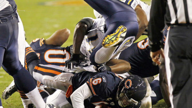 Chicago Bears quarterback Jay Cutler (6) scores on a 1-yard run against the San Diego Chargers in the second half of an NFL football game in Chicago, Sunday, Nov. 20, 2011. (AP Photo/Charles Rex Arbogast)