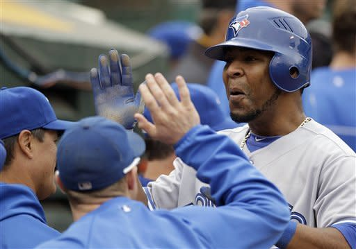 Cooper hits tying HR in 9th, Jays beat A's in 11th