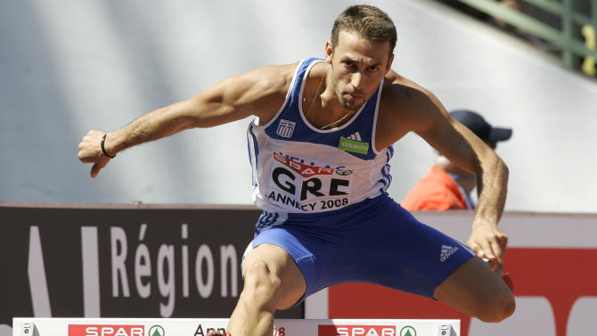 """FILE - In this Saturday, June 21, 2008 file photo, Periklis Iakovakis of Greece competes during the 400m hurdles race at the SPAR European Cup 2008 in Annecy, southeastern France.  For athletes, like Iakovakis, from crisis-hit European nations preparing for the London Games, there are obstacles beyond training. """"Of course, the crisis affects you because the world of athletics, the world of sports, it is part of society,"""" Iakovakis told The Associated Press. """"If you consider I have a family and I have two children, everything is inside my mind because I also have to think of the future."""" (AP Photo/Lionel Cironneau)"""