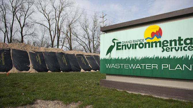 A sand barricade is set up to protect the Grand Rapids, Mich. waste water treatment facility from flood waters is pictured Sunday, April 21, 2013. (AP Photo/MLive.com, Sally Finneran)