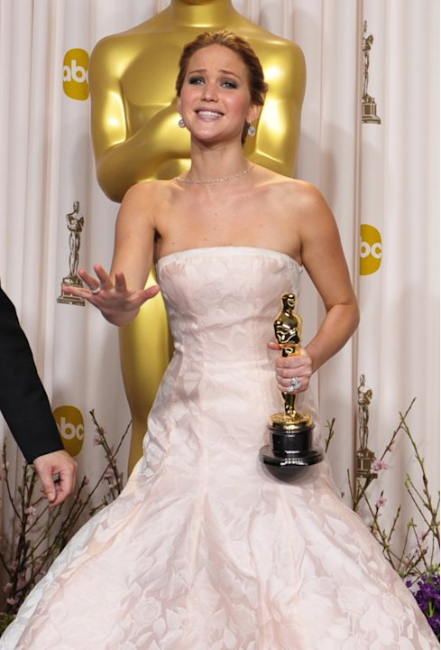 Jennifer Lawrence poses with her award for best actress in a leading role for