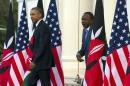 President Barack Obama, left, and Kenyan President Uhuru Kenyatta arrive for a news conference at State House, on Saturday, July 25, 2015, in Nairobi, Kenya. Obama's visit to Kenya is focused on trade and economic issues, as well as security and counterterrorism cooperation. (AP Photo/Evan Vucci)