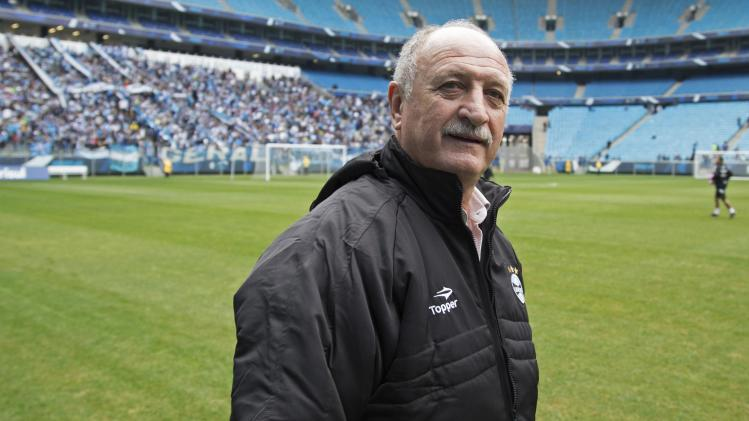 Brazil's former national soccer team coach Luiz Felipe Scolari walks on the field in Porto Alegre