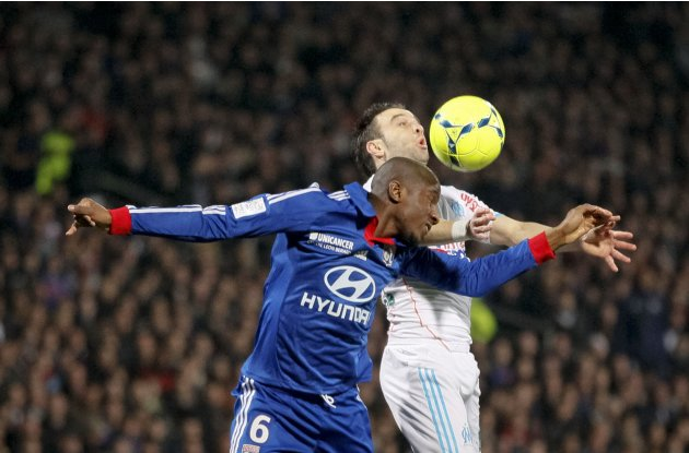 Olympique Lyon's Fofana challenges Valbuena of Olympique Marseille during their French Ligue 1 soccer match in Lyon