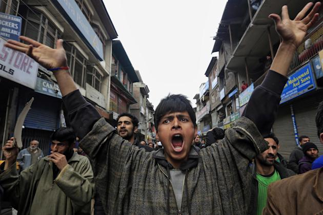 Supporters of Jammu Kashmir Liberation Front (JKLF) shout pro-freedom slogans during a protest in Srinagar, India, Friday, March 7, 2014. Dozens of Muslim students from the disputed Indian territory o